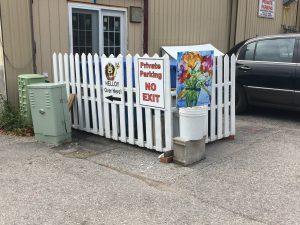Pretty picket fence hiding compost bins