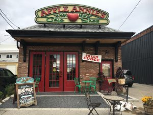 Back entrance of Apple Annie's with patio table
