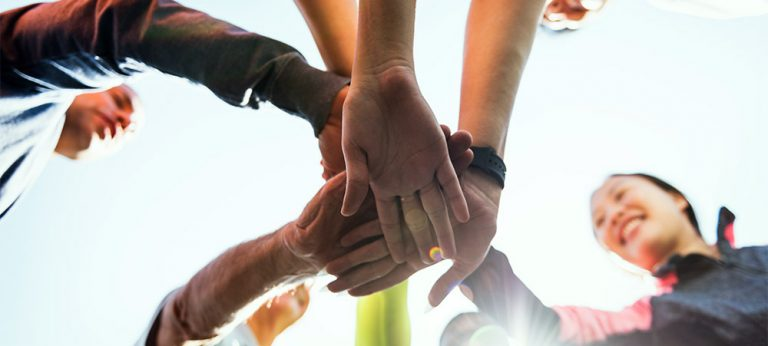 Join Us - group of hands together in circle