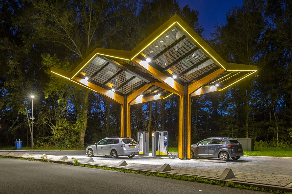 Electric cars charging at electricity filling station